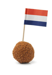 Single dutch traditional snack bitterbal with a dutch flag