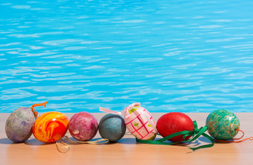 Easter in pool, wellness and relax. Eggs and water background for party and spa