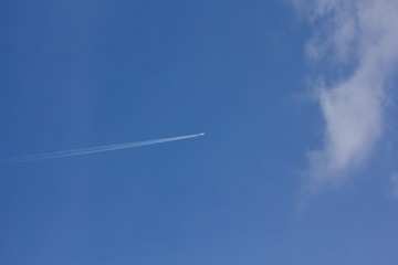 Airplane in the blue sky.
