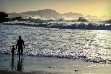 ocean, beach, sunset silhouettes, people, wild water