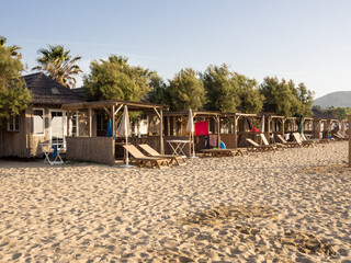 Beach huts in early morning sunshine before sun worshippers appear, Port-grimaud, France