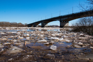 Ice drift on the river and the bridge