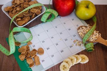 Calendar with health foods on the table