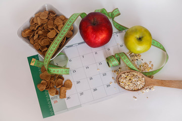 Calendar with health foods on a white background