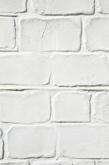 Decorative white stucco imitating brick wall