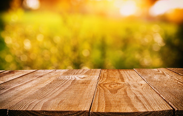 Empty rustic table in front of abstract background