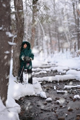 Woman Snowshoeing by Stream