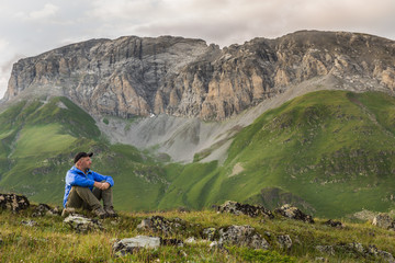 Hiker relaxing in Caucasian rocky mountains