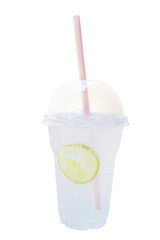 Fresh cold lemon soda, carbonated lemonade soft drink in plastic cup with dome cap and straw isolated on white background, clipping path included.