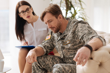 Depressed military man coping with negative emotions