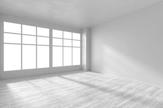 Empty white room with parquet floor, textured walls and big window
