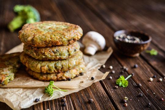 Fried vegetarian broccoli burgers with mushrooms and garlic