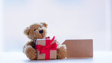cute teddy bear with price tag and beautiful gift on the wonderful white background