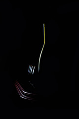 Elegant wine glass and a wine bottles in black background
