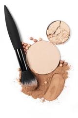 Set of various face powder and brush