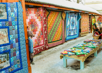 Market series with bright colorful patchwork quilts in winter sunny day