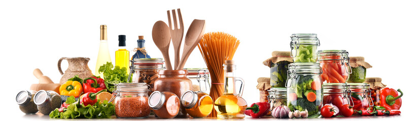 Assorted food products and kitchen utensils isolated on white