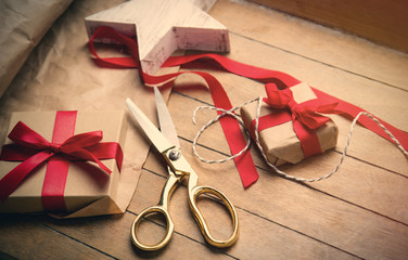 cute gifts, star shaped toy and things for wrapping on the wonderful wooden brown background