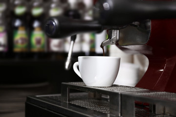Coffee machine with cup, closeup