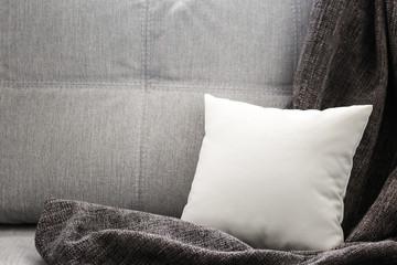 Blank soft pillow on sofa