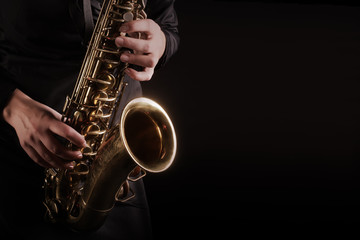 Photo sur Toile Musique Saxophone player Saxophonist playing jazz music instruments