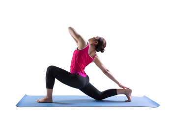 Sporty fit women practices yoga Anjaneyasana exercise bend yoga pose on rubber mat.
