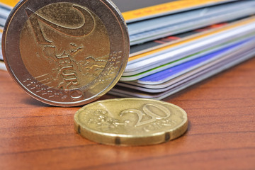euro coins and bank cards