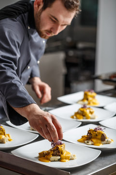 Young chef prepares meals