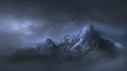 High mountain pass in dramatic misty atmosphere