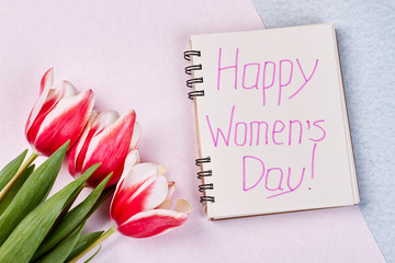 Notebook and flowers. Creative congratulation with Women's day.