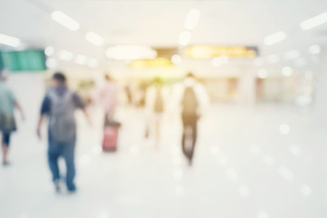 abstract blurred background : crowd people at terminal department at airport with bokeh light.