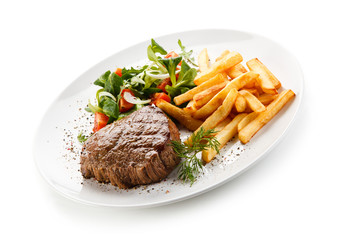 Grilled steak, French fries and vegetables
