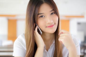 Portrait of thai adult student university uniform beautiful girl calling smart phone