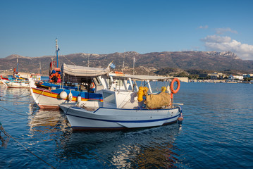 Traditional Greek fishing boats at harbor of Sitia town on eastern part of Crete island, Greece