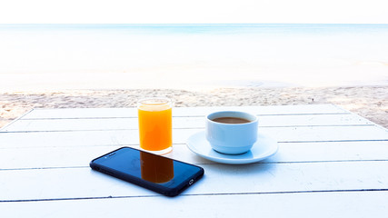 orange juice and hot coffee on the wooden table