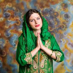 Portrait of beautiful eastern woman in green sari