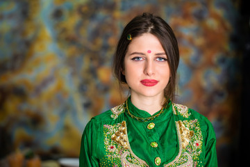 Portrait of beautiful eastern woman in green sari