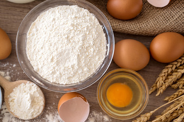 eggs and flour basic ingredients for baking top view .