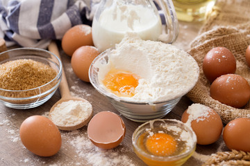 Breaking eggs into flour to making cakes.