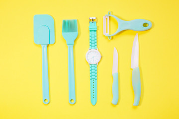 Cooking tools and kitchen utensil on color background