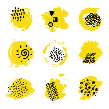 Yellow paint spots with black ink hand marks. Abstract stains for branding design.