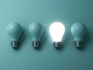 One glowing light bulb standing out from the unlit incandescent bulbs on green background with reflection , individuality and different creative idea concepts . 3D rendering.