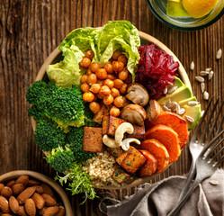 Buddha bowl, healthy and balanced vegan meal, top view