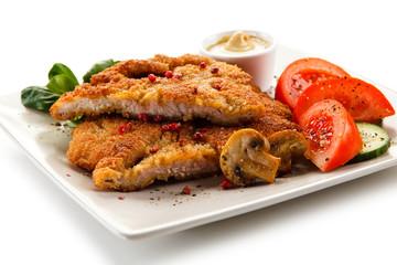 Fried pork chop and vegetables