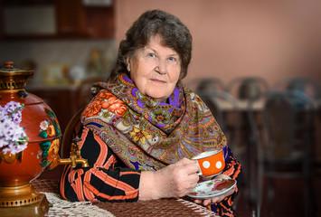 Beautiful Russian woman in traditional dress. Russian style.