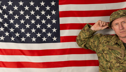 Porttrait of soldier on the background of the USA flag.