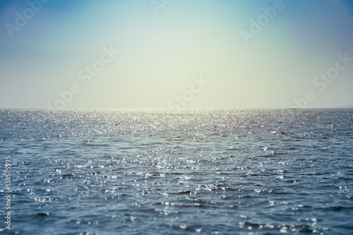 Wall mural Sparkling blue sea water surface