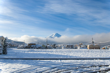 Fuji Mountain view behind village in the first snow in winter season