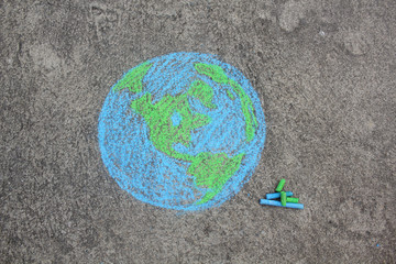 Earth with copy space, street art, drawing with chalk