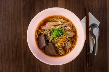 Thailand style duck noodle soup on wooded
